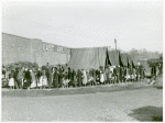 Negro flood refugees lined up and waiting for food in Forrest City, Arkansas camp; Feb. 1937