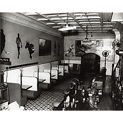 Colonial Inn bar and restaurant with booths on left, tiled floor, and sports figures and large landscape painting on walls