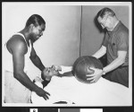Three men working out with a medicine ball, Los Angeles, ca. 1951-1960
