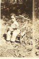 Child Sitting on an Outdoor Bench
