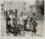 Group posing at street kitchen. Unidentified location
