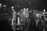 Fire fighters in the street after a riot protesting the Freedom Riders' arrival in Montgomery, Alabama.