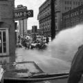 Firemen spraying civil rights demonstrators with a hose during the Children's Crusade in downtown Birmingham, Alabama.