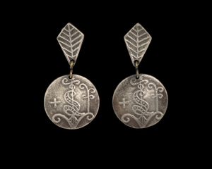 Silver earrings with Vodou veve designed by Winifred Mason Chenet
