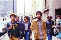 Students Walk on Sidewalk