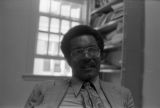 John Blassingame: New York. John Blassingame seated in office, Fredrick Douglas portrait on the wall (BLJP 1-79 #101)