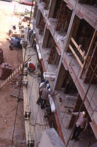 Construction Workers Working on High-Rise