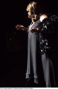 Performer with a black feather boa Hip Hop Broadway: The Musical