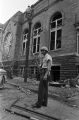 Police officer standing outside of 16th Street Baptist Church in Birmingham, Alabama, after the building was bombed.
