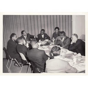 Reverend Michael E. Haynes attending a meeting.