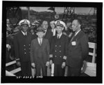 [Untitled negative showing Captain Adrian Richardson (third from left) and part of the crew on the day of the launching of the Liberty ship SS Frederick Douglass, Baltimore, Maryland]