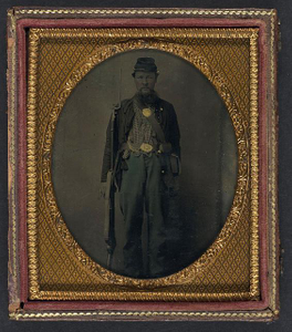 [Unidentified soldier in Union uniform with bayoneted musket, haversack, cap box, and cartridge box]