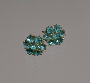 Pair of teal rhinestone flower earrings from Mae's Millinery Shop