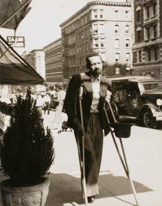 Untitled (man on crutches)