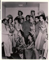 Photograph of Lionel Hampton with members of the Moulin Rouge show group, 1955
