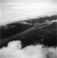 Équateur province (Democratic Republic of the Congo), above clouds aerial view of Congo River and forest
