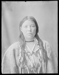 Front view Assiniboin girl wearing ten strand narrow bead and bone necklace, very fine before 1912