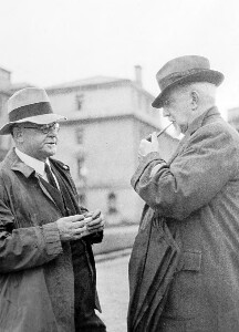 Two unidentified men talking.