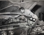 MVAS (Milwaukee Vocational and Adult School) African American Automotive student performing electrical analysis on vehicle in T-Building - June 1961.
