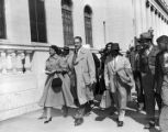 Autherine Lucy and her lawyers, Thurgood Marshall, Arthur Shores, and Constance Baker Motley, walking past the federal courthouse in Birmingham, Alabama, on the day a federal judge ordered her readmission to the University of Alabama.