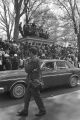 Car passing down the street during the funeral procession for Martin Luther King, Jr.