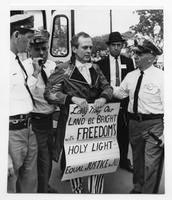 Clergyman arrested in anti-segregation fight.