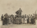 Group of African American women standing in front of the Booker T. Washington monument in the center of the Tuskegee Institute campus.