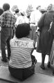 """Woman from the Medical Committee for Human Rights, seated on the steps outside a building during the """"March Against Fear"""" through Mississippi."""