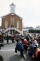 Marchers kneeling in front of Dexter Avenue Baptist Church in Montgomery, Alabama, at the conclusion of the 20th anniversary reenactment of the Selma to Montgomery March.