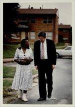 Eva Davis talks with Michael Janis during a walking tour of East Lake Meadows, June 24, 1991