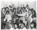 """Richard J. Daley with group of African Americans at a """"We Care"""" event"""
