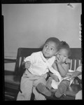 """Ocia Mae Miles and brother Herman at hospital after eating some """"strange bluish powder"""" in Los Angeles, Calif., 1949"""