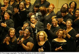 Choir members clapping and singing Black Music and The Civil Rights Movement Concert, featuring Chrisette Michele & Ledisi.