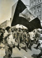 Marchers wave banner