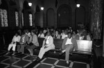Robert Farrell's hearing participants listening to testimony on red lining, Los Angeles, 1985