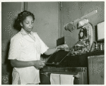 African American Private Hannah Wills developing an x-ray film in the x-ray laboratory at Post Hospital, Camp Breckinridge