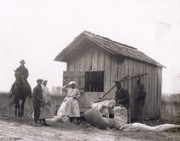 African Americans weighing cotton on the Stovall Plantation. [Southeastern Missouri].