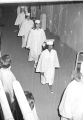 Susie Sanders and other female students walking in line during their graduation from Sidney Lanier High School in Montgomery, Alabama.
