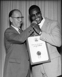 Kenneth Hahn welcoming Larry Holmes, Los Angeles