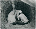 The cement well cap is lowered down the cleared well with a two purchase block and tackle. John Hardesty Well Project, Charles County, Maryland, July, 1941