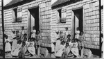 A Negro family beside their cabin. S. Carolina