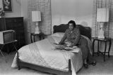Jean Jackson reviewing photographs and documents in a bedroom of her home on Lapsley Street in Selma, Alabama.