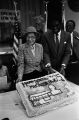 Rosa Parks and Mayor Johnny Ford displaying her birthday cake on Rosa Parks Day in Tuskegee, Alabama.