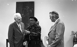 Blues musician Jesse Fuller speaking with KPIX general manager Al Constant (left) and former museum director John Peetz during concert at the Oakland Museum