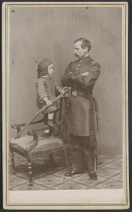[Unidentified soldier in Union first lieutenant's uniform and child in Zouave uniform with model 1860 cavalry saber]