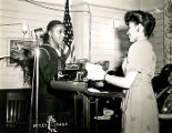 African American sailor and unidentified African American woman during World War II