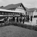 Children lined beside a bus for Nazareth Catholic School, a school for African American children sponsored by the Nazareth Catholic Mission in Montgomery, Alabama.