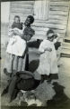 African American woman with children and cast iron pot