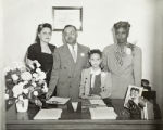 Hicks family portrait in an office