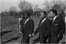 Martin Luther King, Jr., Andrew Young, and others arriving for a meeting at a small rural church building in Greenville, Alabama.